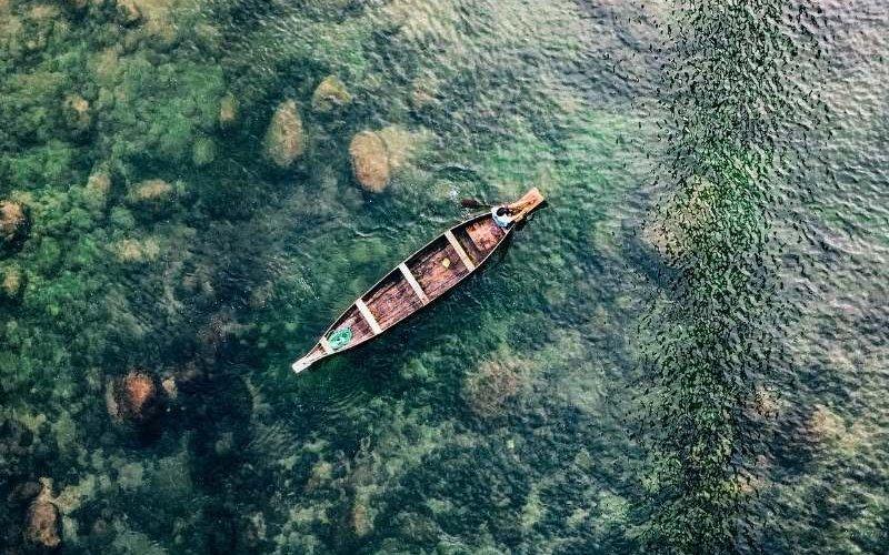 Boating in Umngot River at Dawki - Meghalaya Tour Package
